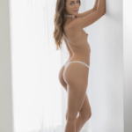 Ally Tate showing off her spankable bottom in white panties